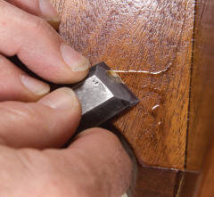 Use a sharp chisel to get dried drips