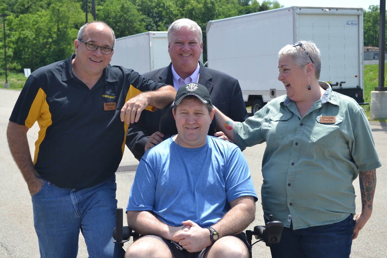 Dan Habjanetz, Tom Kilgannon and Leslie Struthers pose with Greg after the wheelchair presentation event.