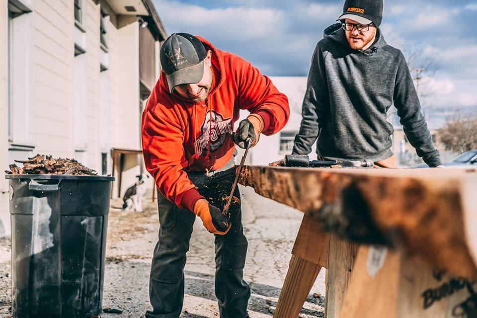 Removing bark with a drawknife