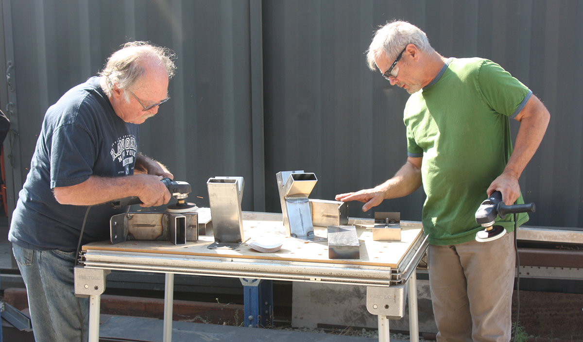 Bruce and San Francisco art studio owner David polish up their welds with the angle grinder.