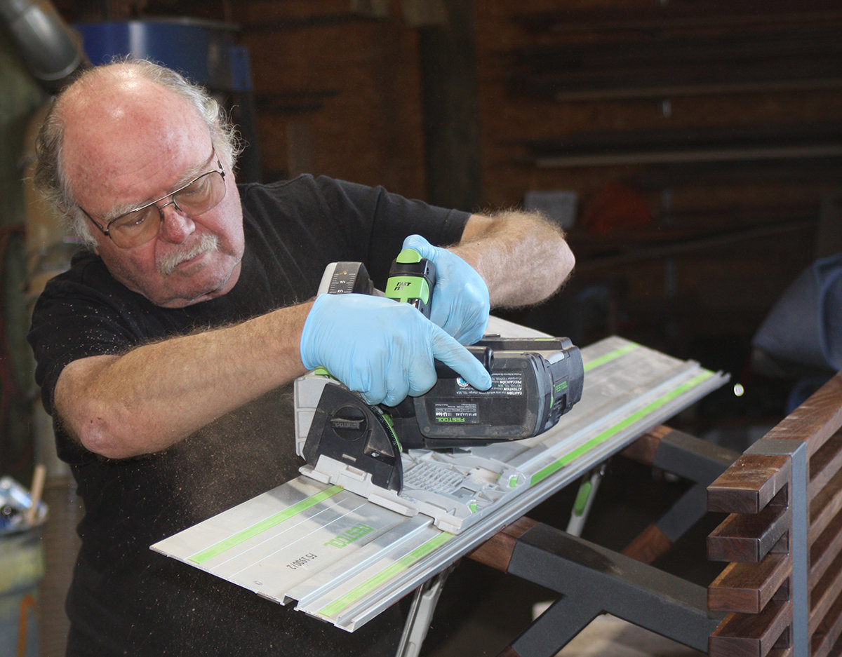 Bruce levels the bottoms of his bench legs with a Festool TS Saw and T-Track.
