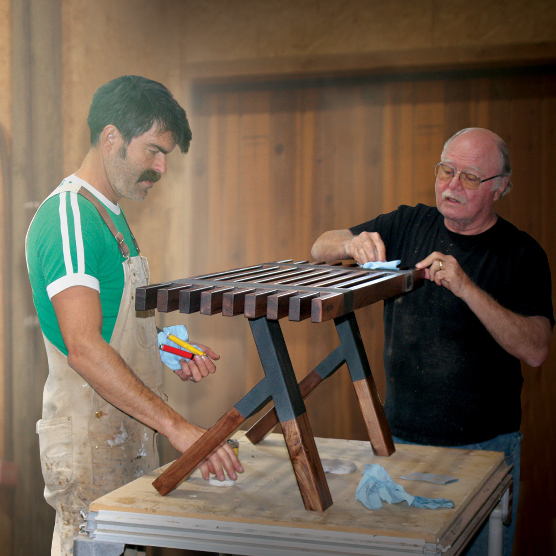 Bruce puts the final touches on his custom bench as Jory looks on.